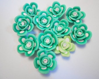 Flower polymer as pictured 11 beads drilled size 2.5 cm