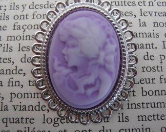 Metal with purple cameo brooch