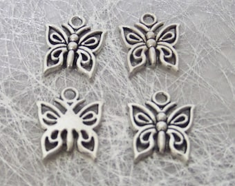 4 charms in silver for creating jewelry butterfly.