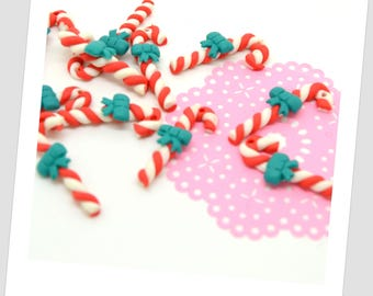 Lot of 10 charms in the shape of barley sugar, with green knot