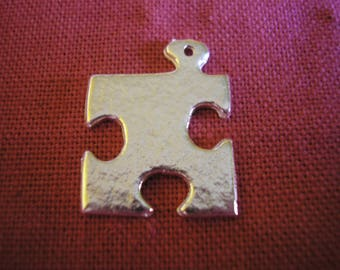 Silver plated puzzle piece charm