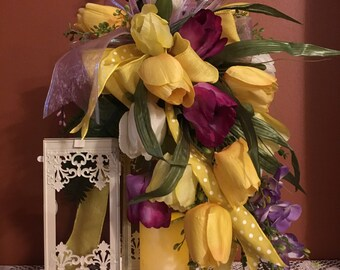 Cascading Tulips Lantern will be the WOW factor anywhere in your home. Multi color tulips adorn beautifully detailed lantern