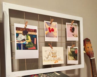 Simple white homemade photo-montage frame