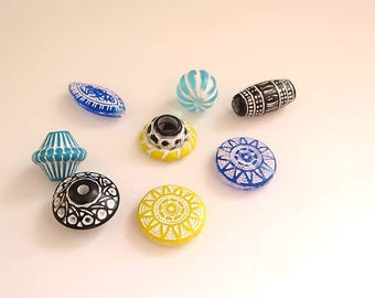 set of 8 beads in different colours blue, yellow and green