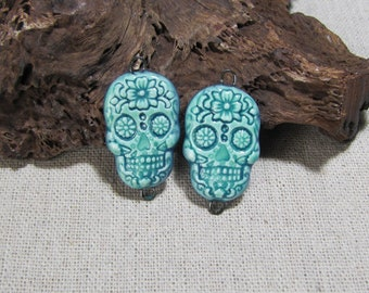 2 skull connector charms for artisanal ceramic creation, jewelry supplies, bright blue turquoise, earring