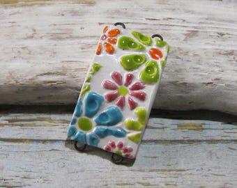 Creative flower power hippie Bohemian multicolored ceramic bracelet connector white background