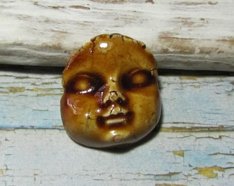 Altered face, baby, child, rustic artisan ceramics, cabochon design jewelry, painting, mosaic, collage, crimping