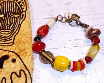 African bracelet in glass beads, carnelian and brass.