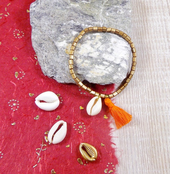 Cauri shell necklace and pompom
