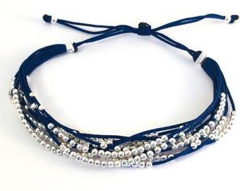 Dark blue multi strand pearl bracelet
