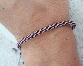 Japanese weave bracelet says kumihimo pink and black