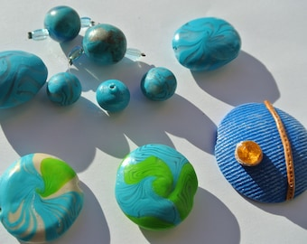 lot of eleven pieces of polymer clay in shades of blue