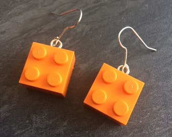 pair of orange lego earrings