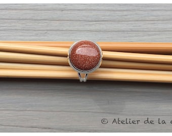 Silver-plated ring with godsend stone cabochon