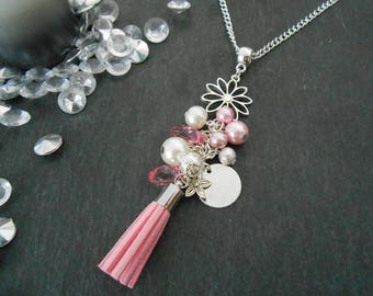 Necklace featuring a pink tassel, beads and charms