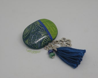 Oval brooch in green and blue polymer clay.