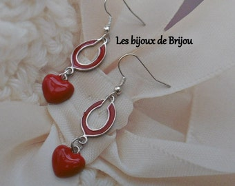 Silver and red metal earrings, horseshoe and heart