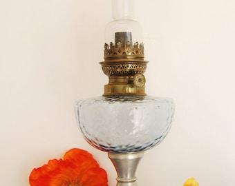 Old oil lamp, lamp vintage retro, French antique flea market in Paris, french antique design, blue glass