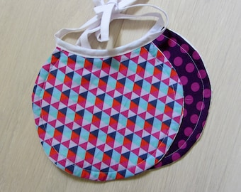 Set of two matching round bibs Triangles and dots