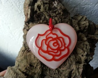 heart pendant with red resin