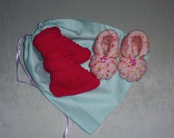 Pair of hand knitted booties pink and Heather pink