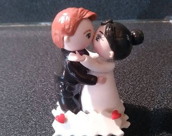 Figurine of marriage: Cake topper on base of cold porcelain bride and groom character.