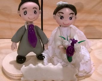 Wedding: picture holder with character from cold porcelain bride and groom.