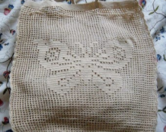 bag is ecru color crochet with woven in Butterfly pattern