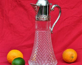 Decanter with silver plated cap