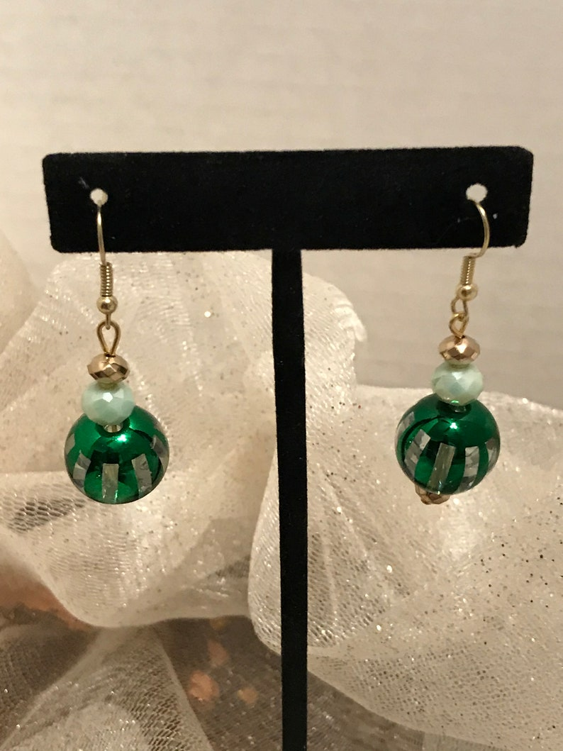 Green stripes with either silver or gold bead earrings