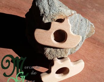 Natural wooden teething ring. Boat shape.
