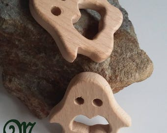 Natural wooden teething ring. Penguin.