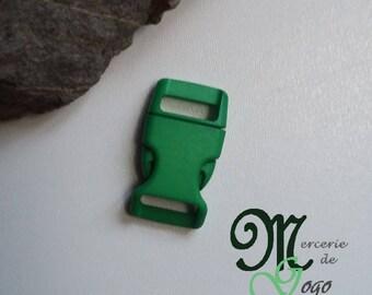 Green plastic quick release clip buckle.