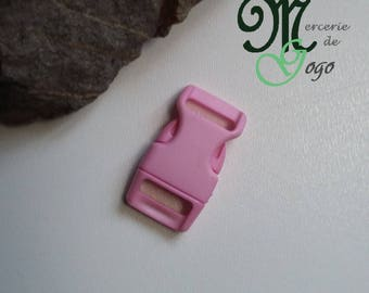 Pink plastic quick release clip buckle.