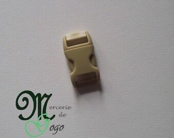 Mini dark beige plastic quick release clip buckle.