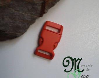 Dark orange plastic quick release clip buckle.