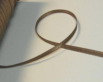 Length of 3 meters of satin ribbon, 3.5 mm light brown.