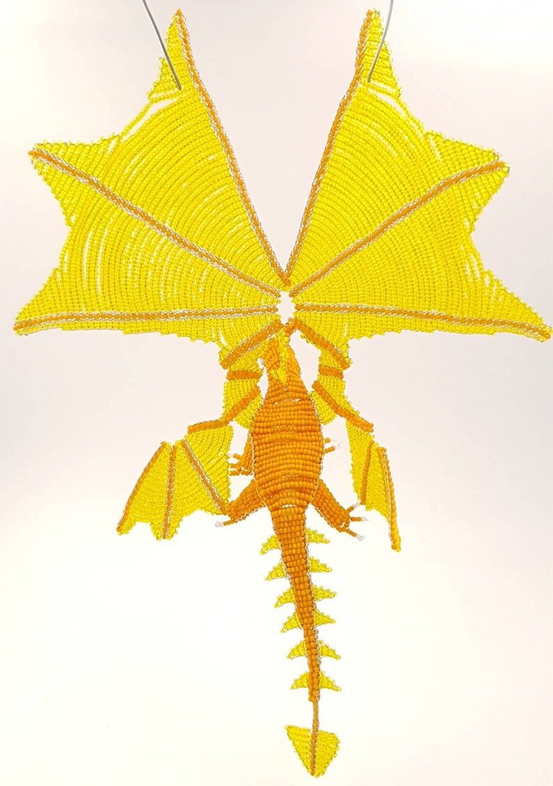 Orange and yellow dragons in pearls