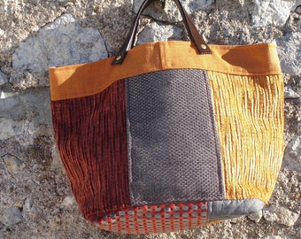 tote bag in velvet and fabrics in shades of gray and orange