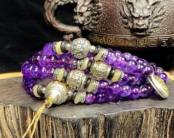 mala, rosary of prayer and Buddhist meditation. 108 amethyst beads, silver 925, mantra of compassion Om Mani Padme Hum.