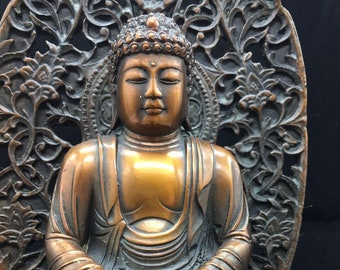 copper and bronze Buddhist statue Buddha Amitabha.