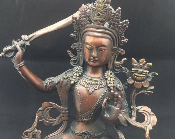 bronze and copper bodhisattva Buddhist statue of Manjushri