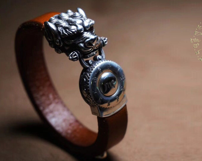 Tibetan Buddhist protection bracelet, the snow lion, mantra rotating, 925 sterling silver, leather, Ruby Burmese.