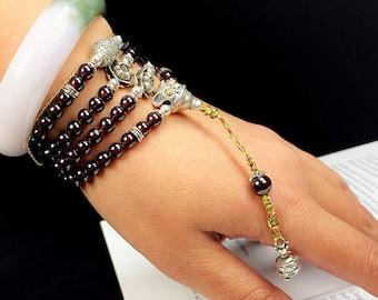 Mala, Buddhist prayer and meditation rosary. 108 pyrope garnet beads. Silver 925. Tibetan bell drilbou