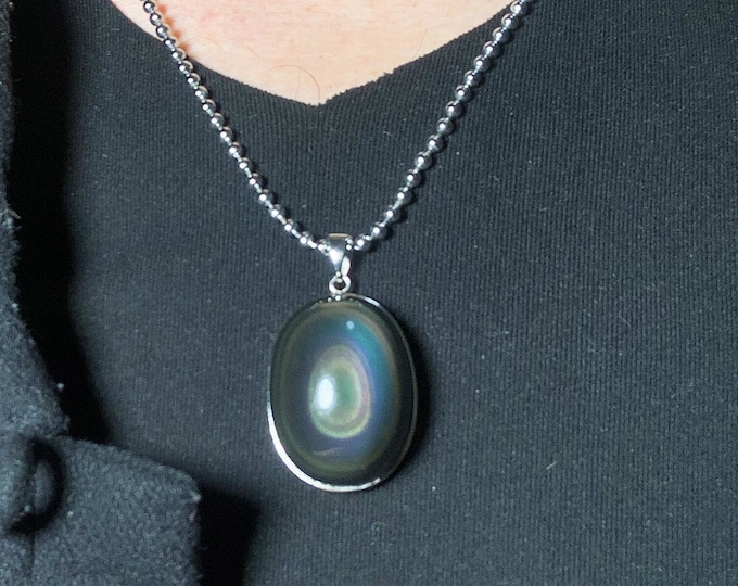 Pendant, obsidian celeste eye of Mexico of high quality. 925 silver crimping. Dimensions 33/25/18mm