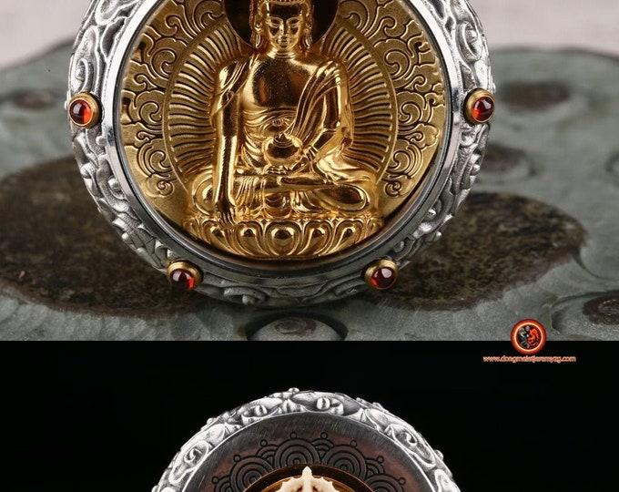 amulette pendentif de protection bouddhiste Bouddha médecine Dorje en ivoire de mammouth tournant au verso Argent 925, or 24K ébéne, grenat.