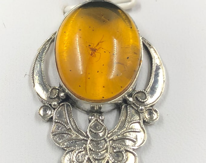 traditional pendant, Pekinoise jewelry. Amber from Burma has spider inclusion. Silver 925