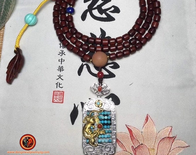 Mala, Buddhist rosary, 108 red sandalwood beads of A-grade. Pixiu pendant, son of the dragon, silver 925, turquoise. Lapis lazuli.