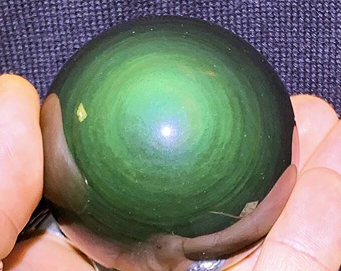 obsidian eye celeste sphere of quality A. 0.254 kg 19.47cm circumference 6.20cm in diameter
