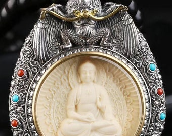 Amulet, Tibetan Buddhist protection reliquary Buddha Amitabha and Garuda ivory mammoth massive silver 925 mantra turning on the back